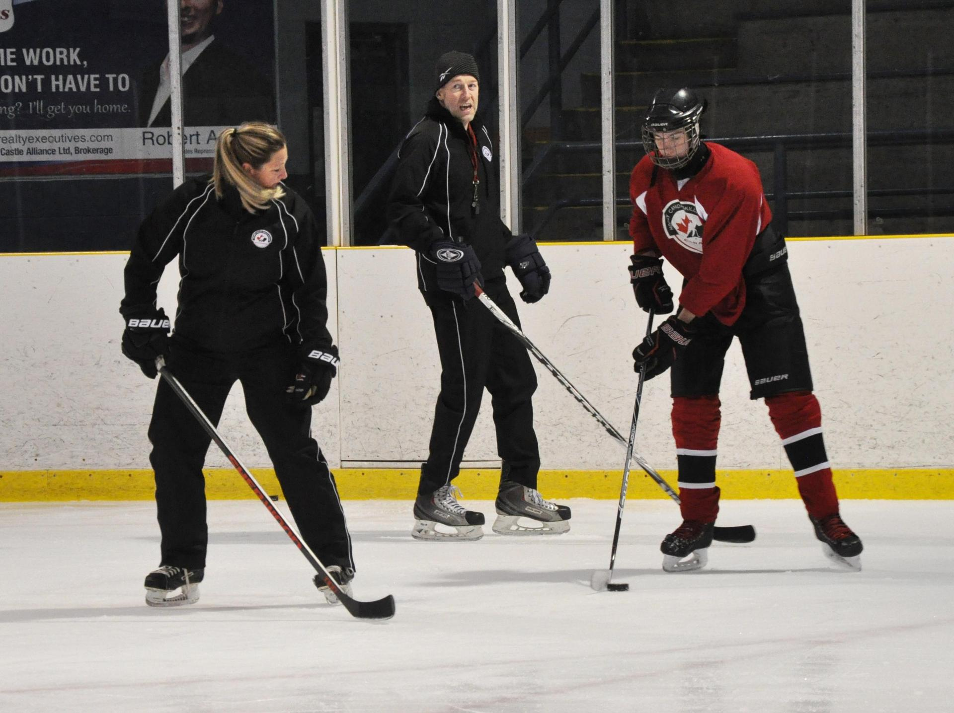 coaches and students on ice