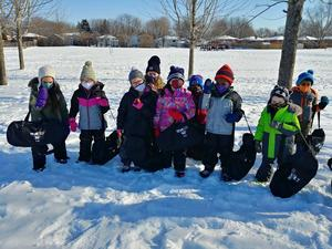 St. John -Guelph students enjoy an outing with their new snowshoes.