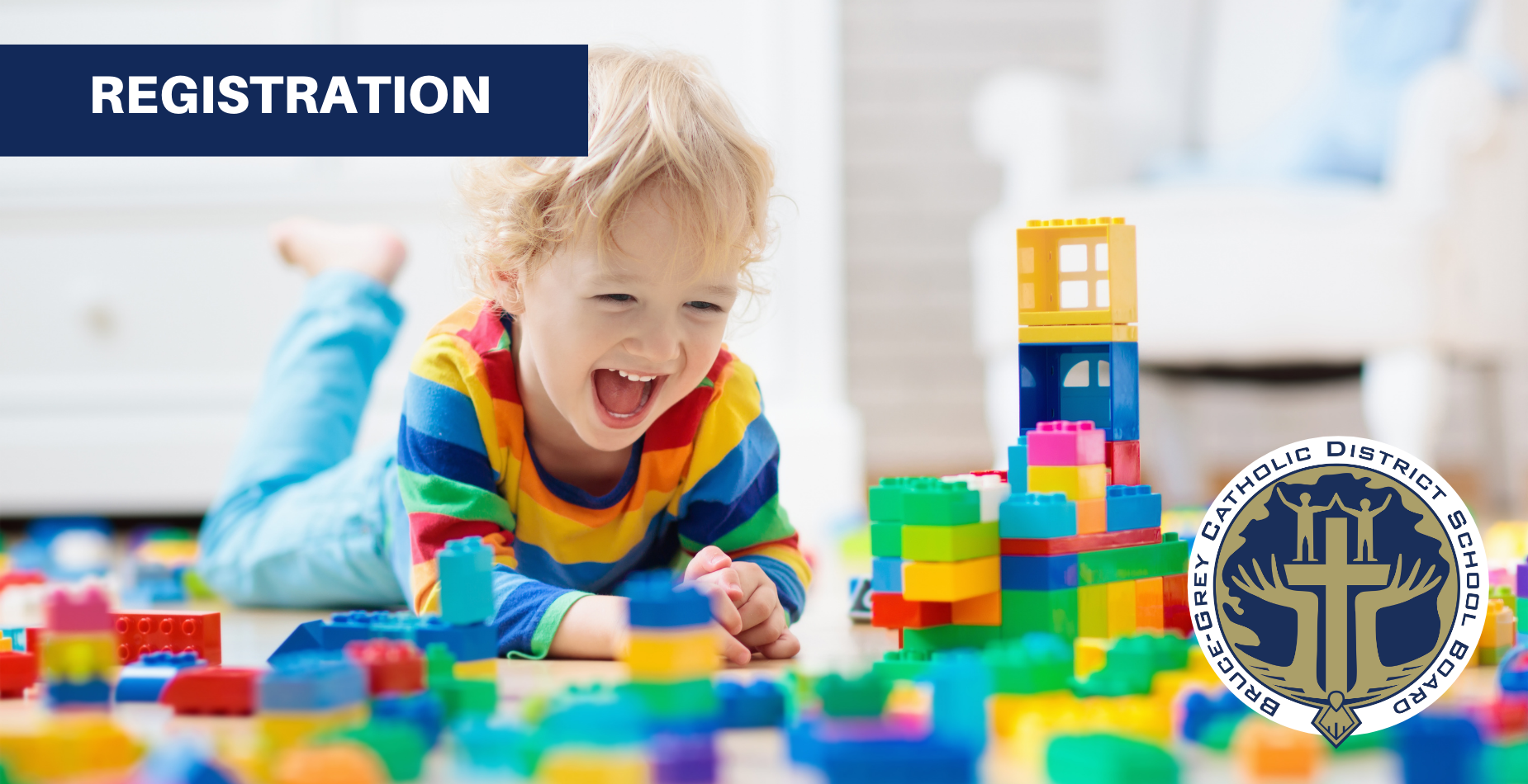smiling child playing with blocks with text saying Registration