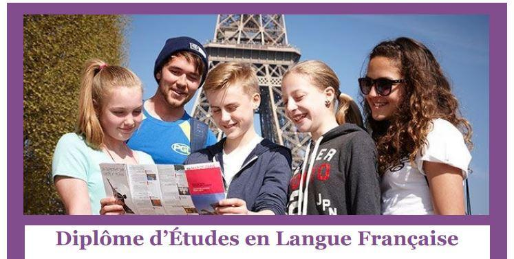 Students looking at French Immersion brochure in front of Eiffel Tower