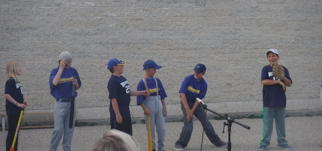 Students performing a baseball skit.