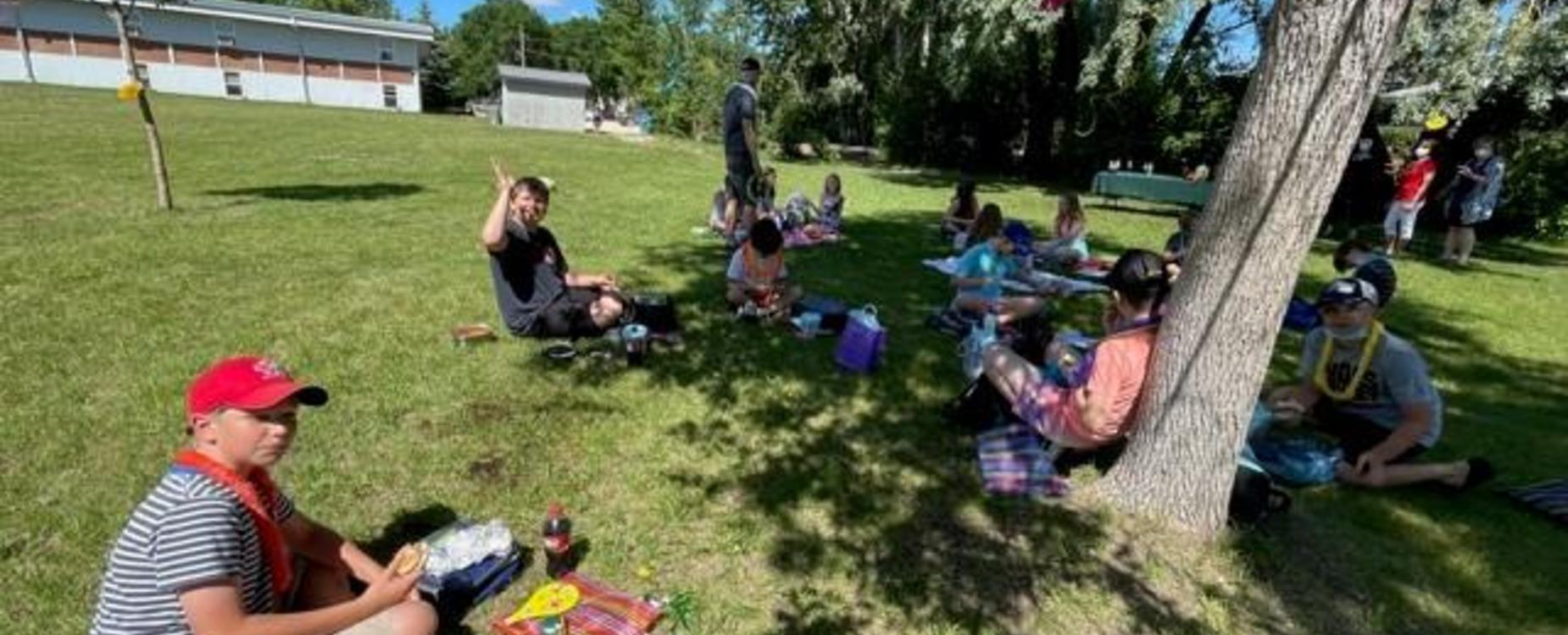 Grade 5 students having a farewell picnic lunch outside
