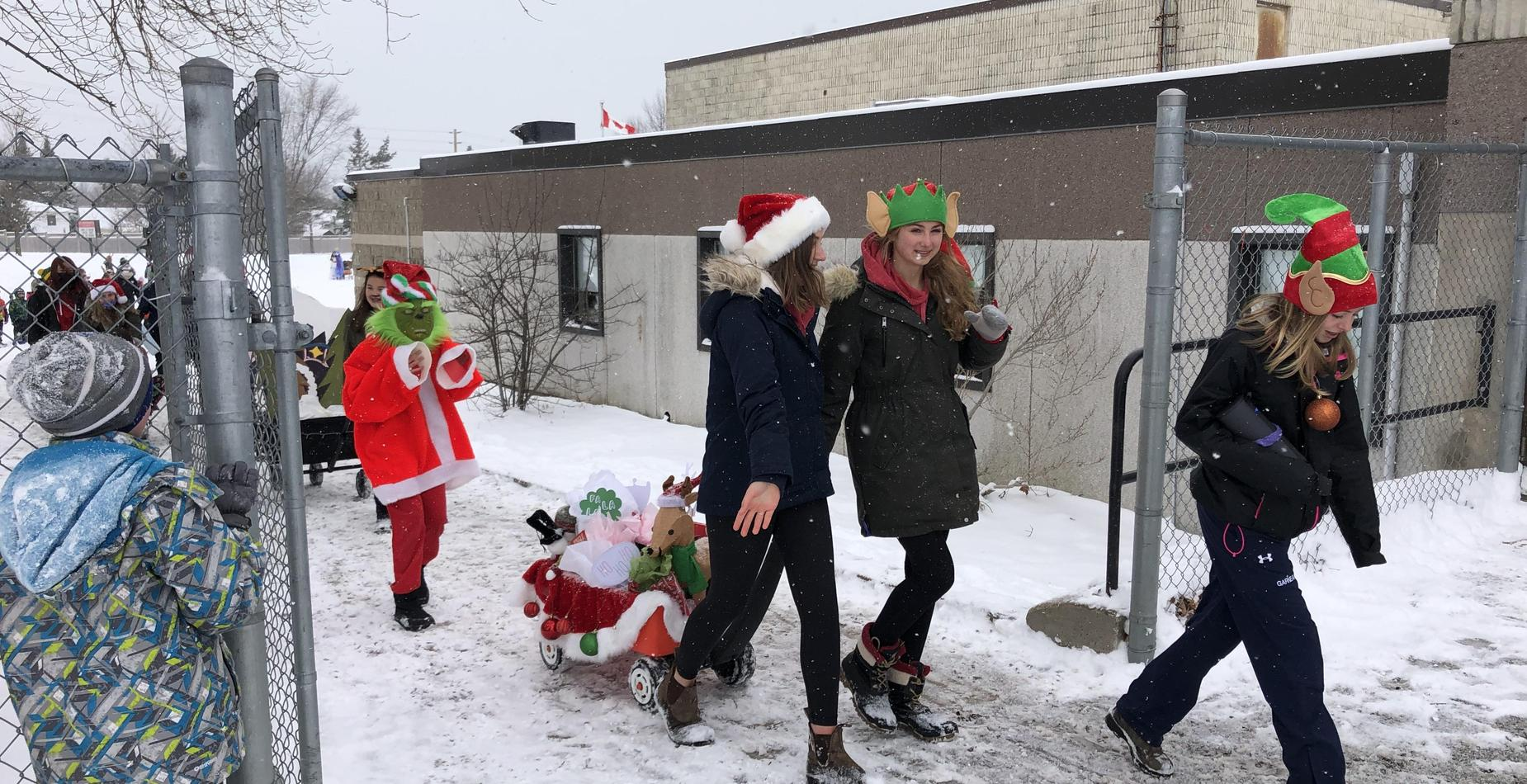 Grade 7/8 students walking in Christmas Parade