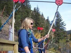 Woman preparing to go on a zipline.