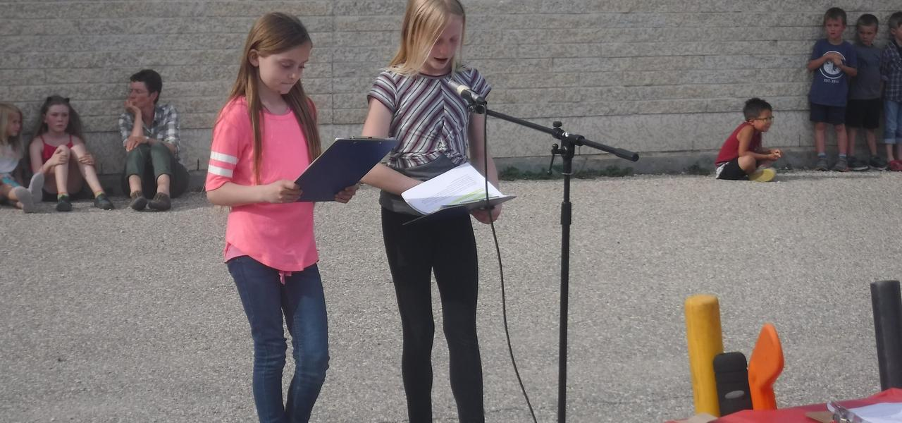 Students announcing the next act.
