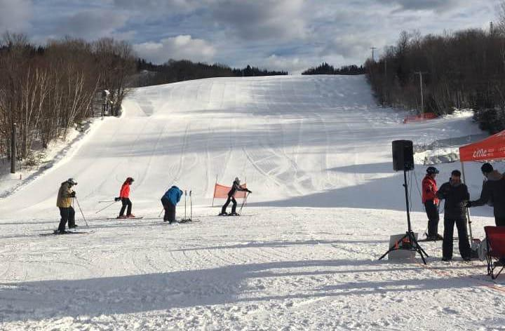 Photo of students skiing on snowy hill