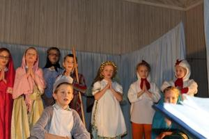 A group of elementary students acting in a Christmas play.