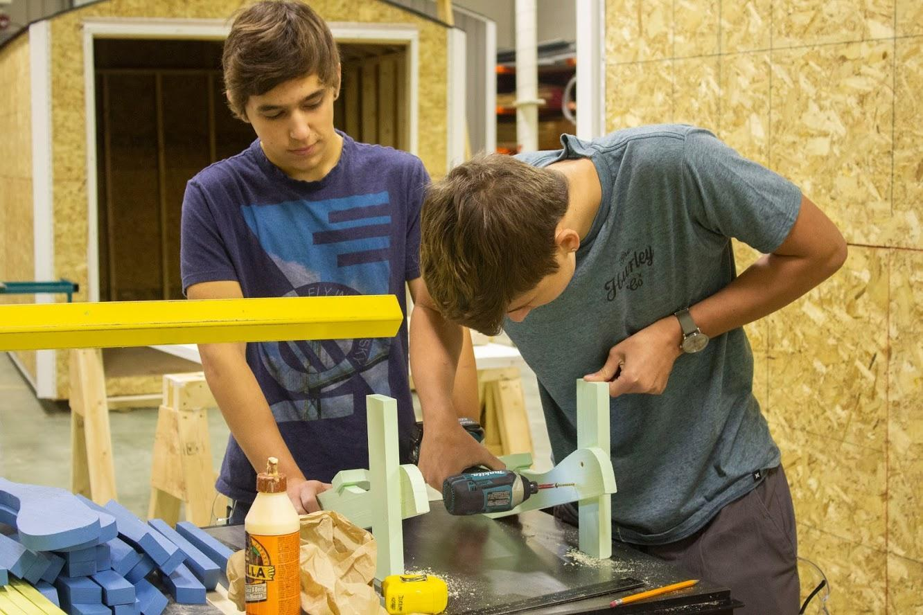 students working on carpentry