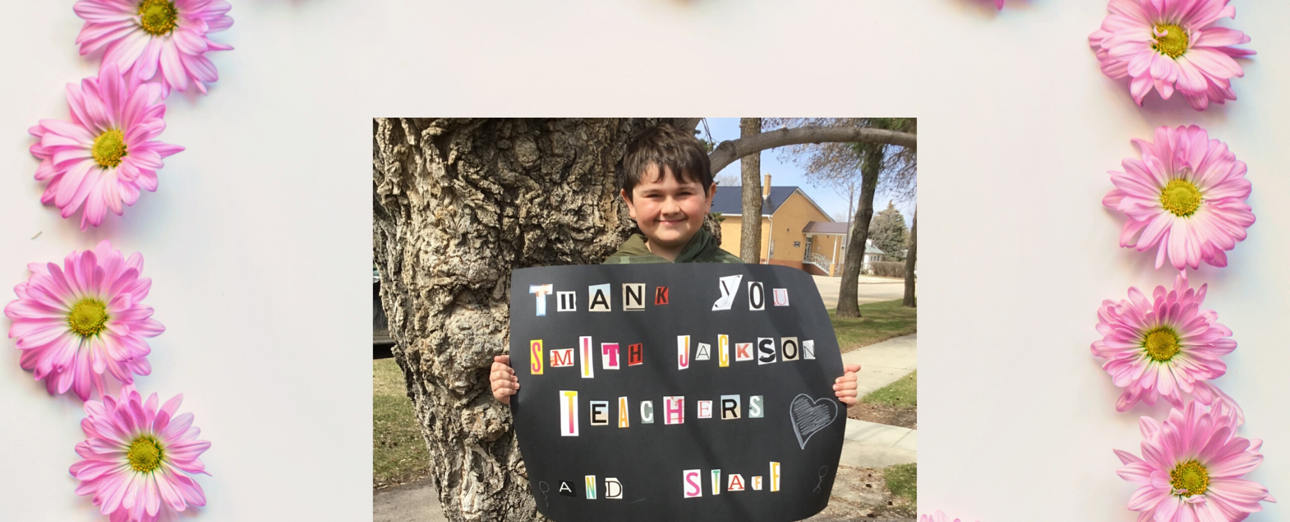 Boy holding thank you sign
