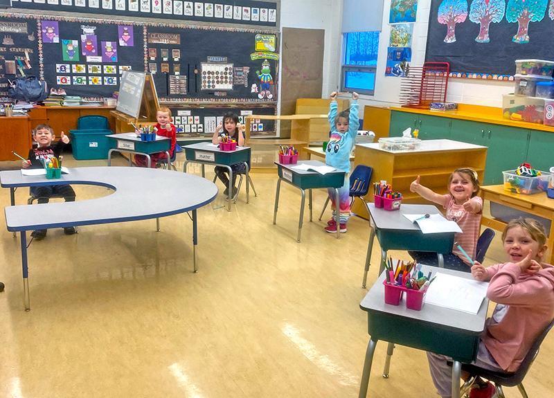 Kindergarten students seated at their desks