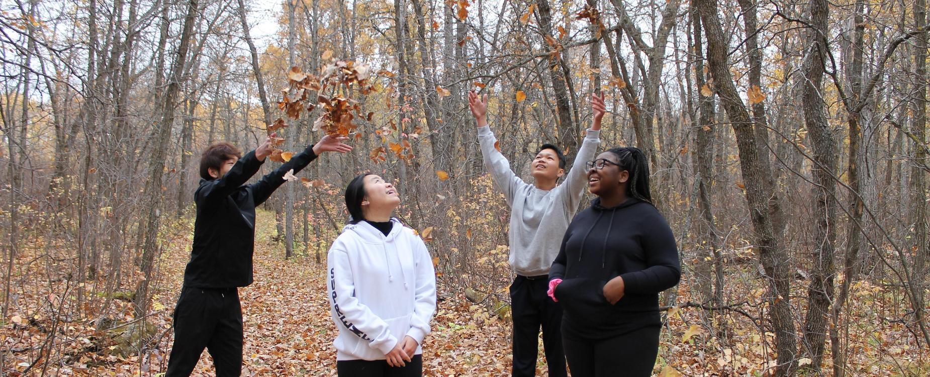 throwing fall leaves in the air