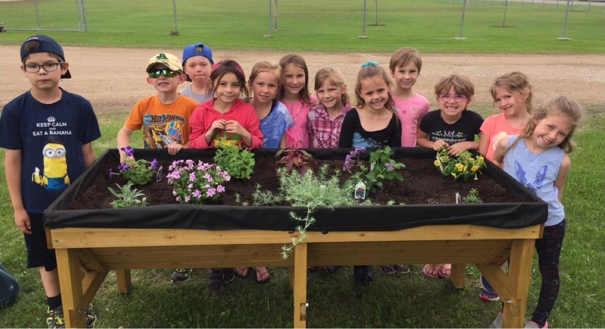 students with garden box