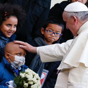 Pope with his hand over a sick boy