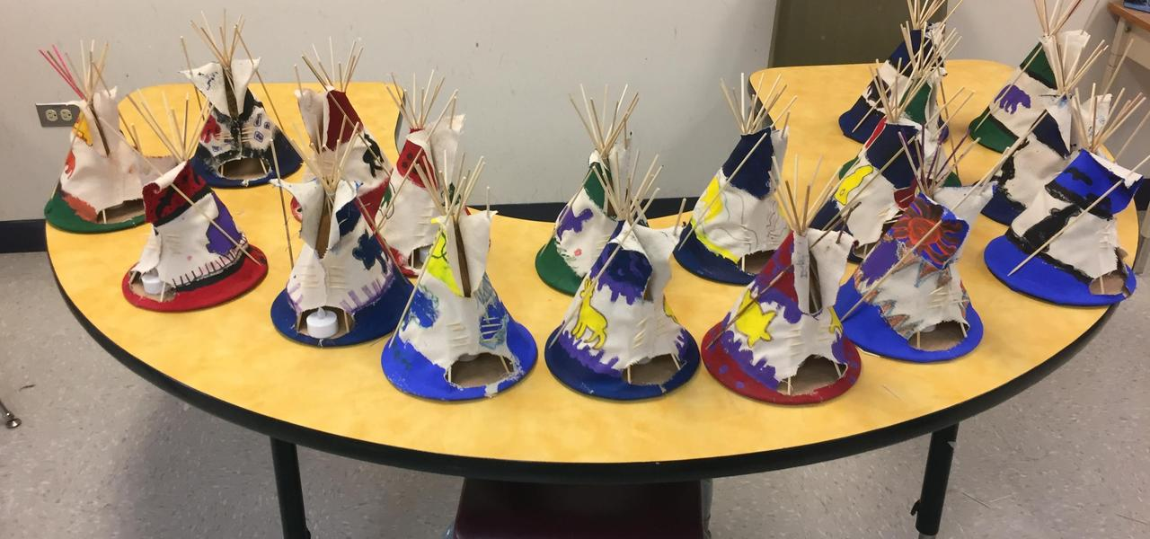 A collection of tipis painted by students