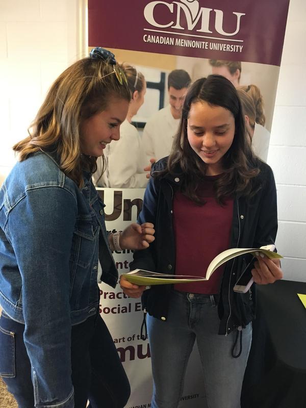 girls reading brochure