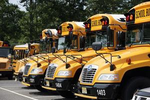 A row of school buses lined up