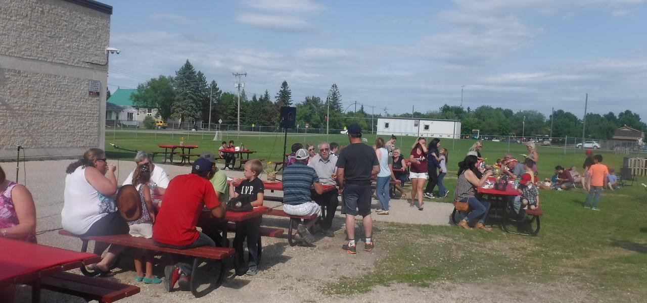 Community members enjoying a meal outside.