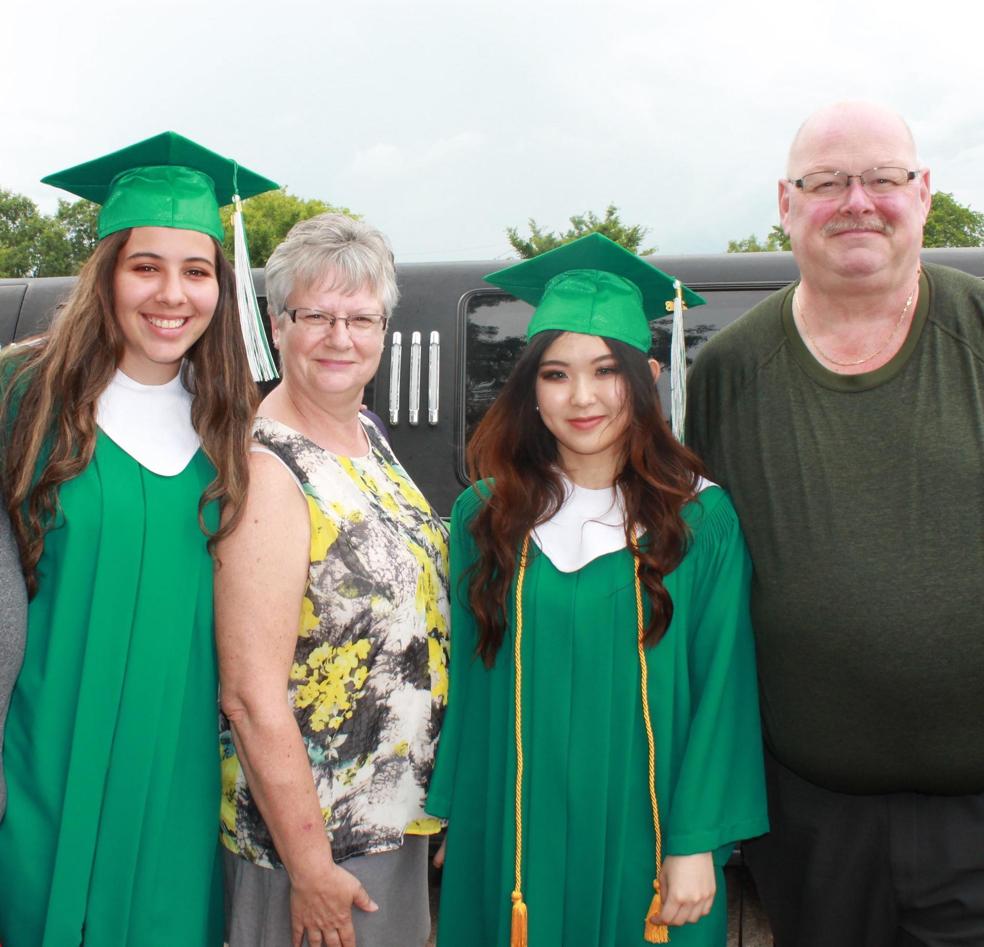 graduates with homestay family