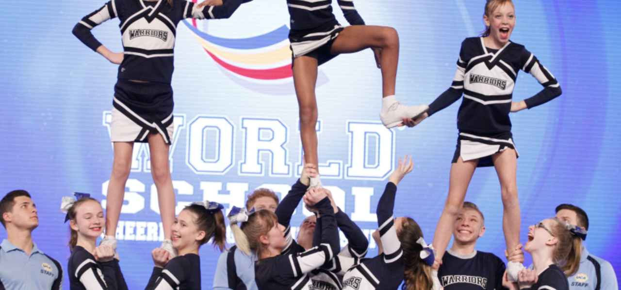 Cheerleaders doing a stunt.