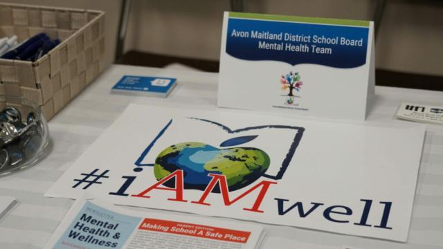 registration table at you matter event showing iam well poster