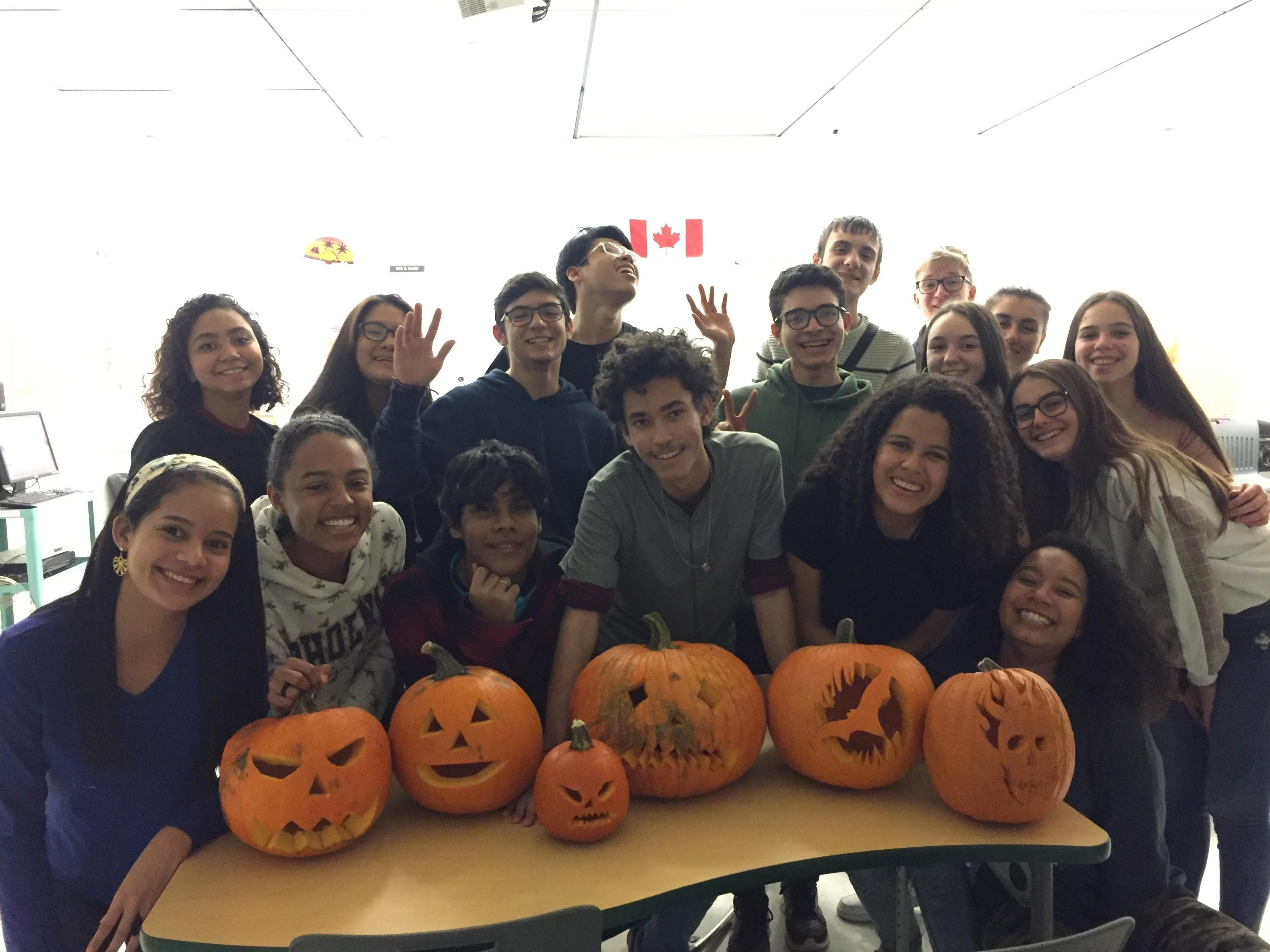 English Class students and their pumpkins