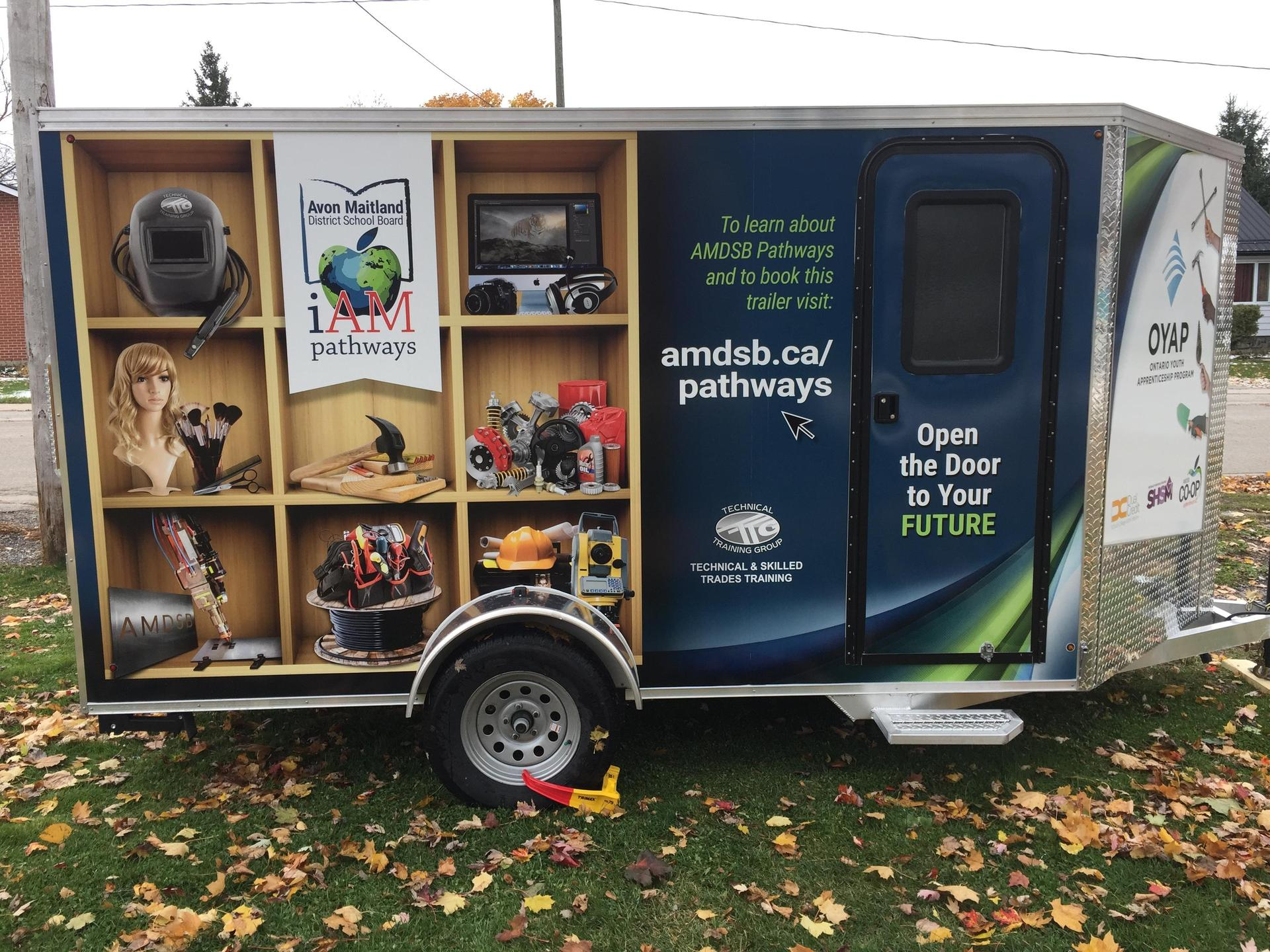 Image of utility trailer with custom Pathways graphics