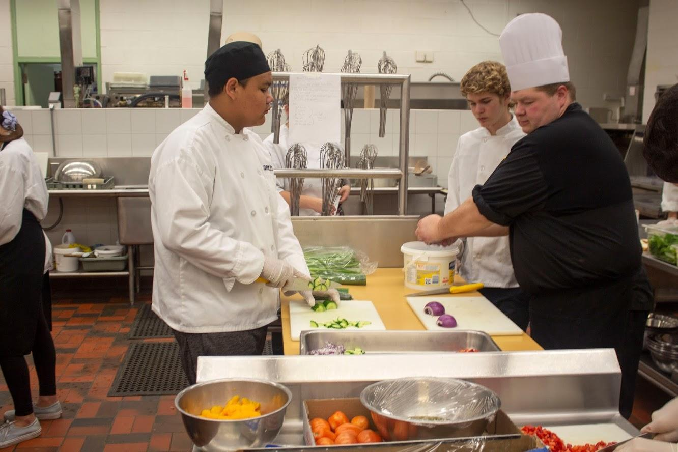 students preparing food in the kitchen for Culinary Arts