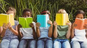 Kids reading behind books