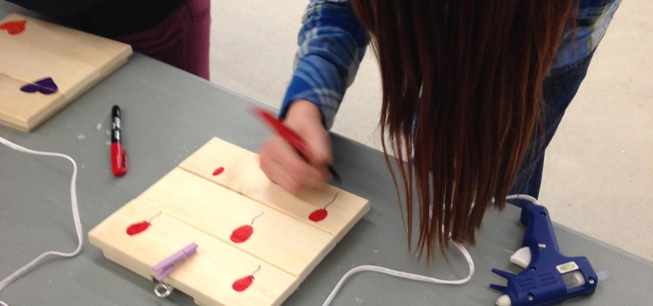 A young girl building an electrontics project