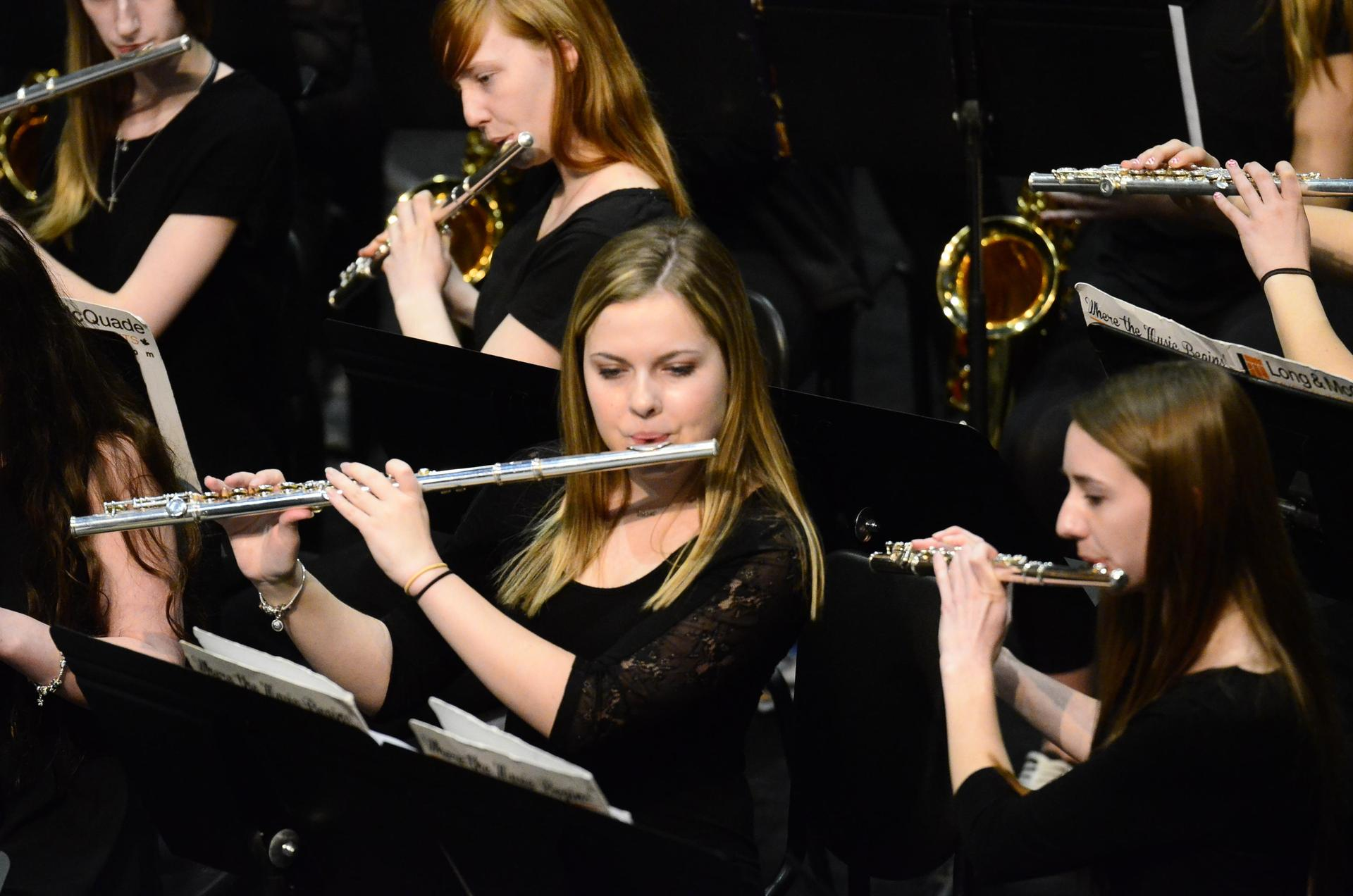 girl playing the flute in band