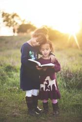 kids hugging in grass
