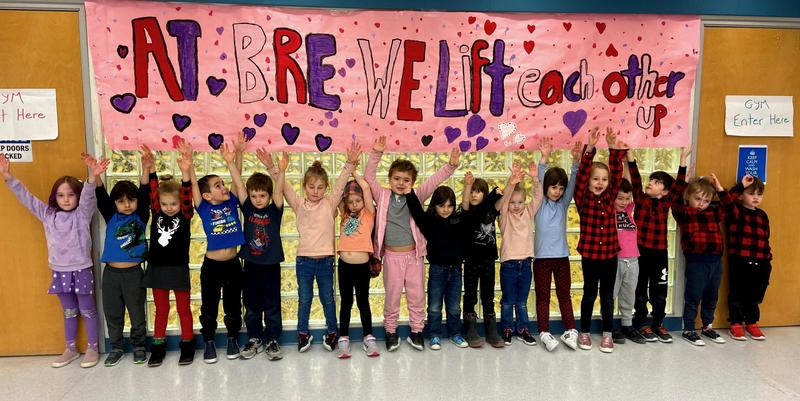 students in front of pink shirt day mural