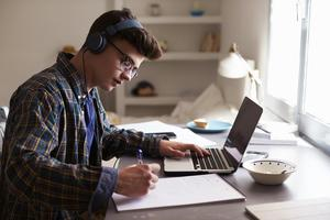Male-Student-Laptop-At-Home-med.jpg