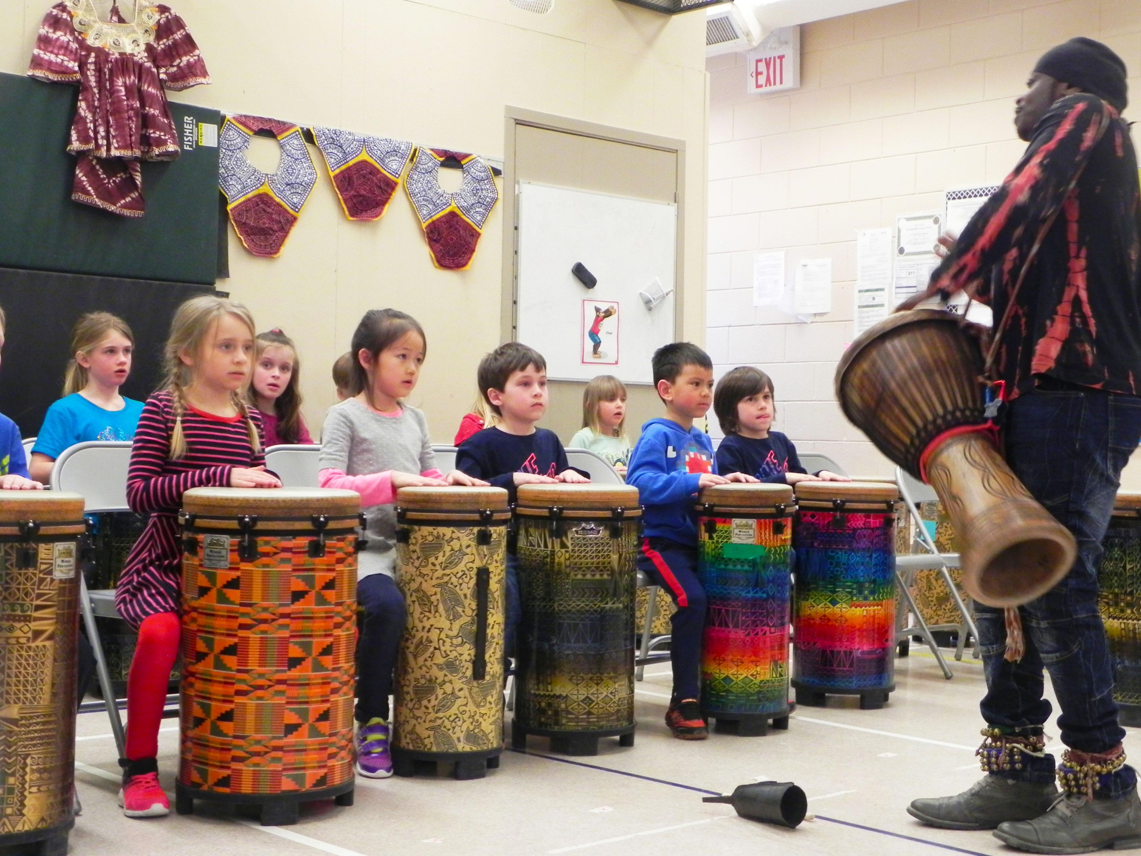 Students drumming.