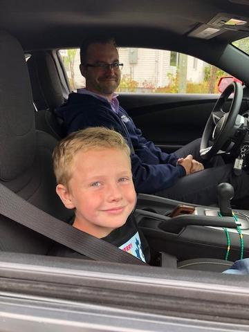 Aiden and Mr. Bonneteau in Mr. Bonneteau's car leading the Terry Fox run.
