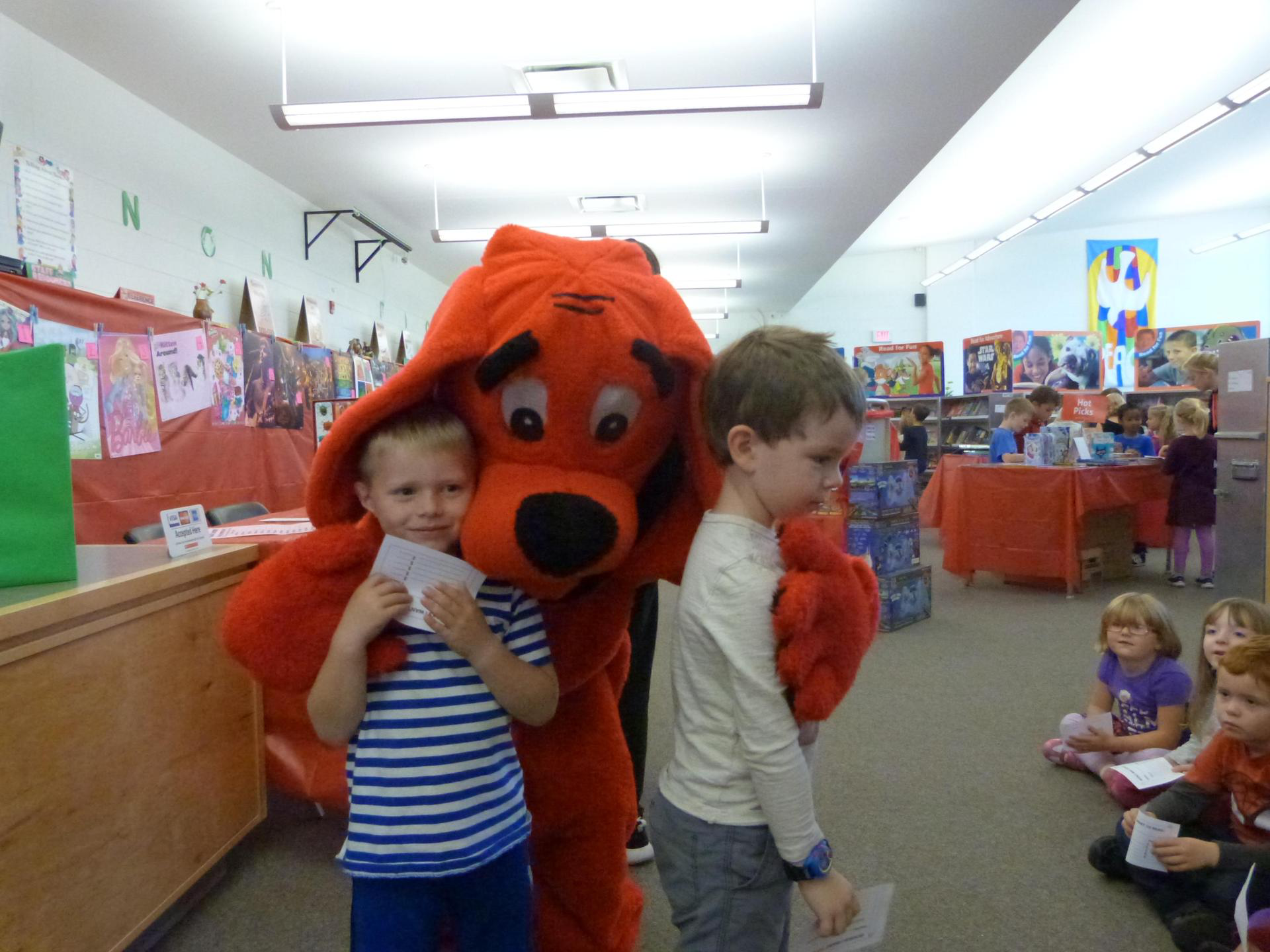 two students hugging Clifford