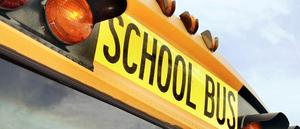 Picture of the top of a school bus that reads