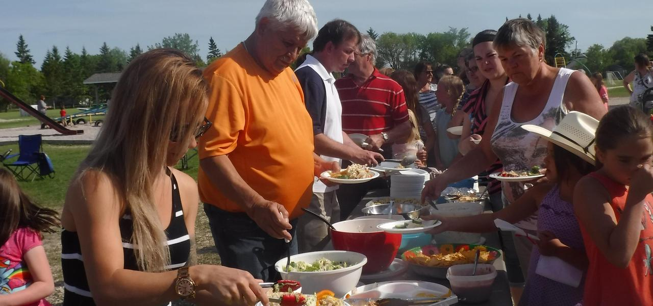Community members dishing up for the picnic.