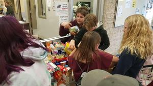 Students organizing the food collected for the food bank.