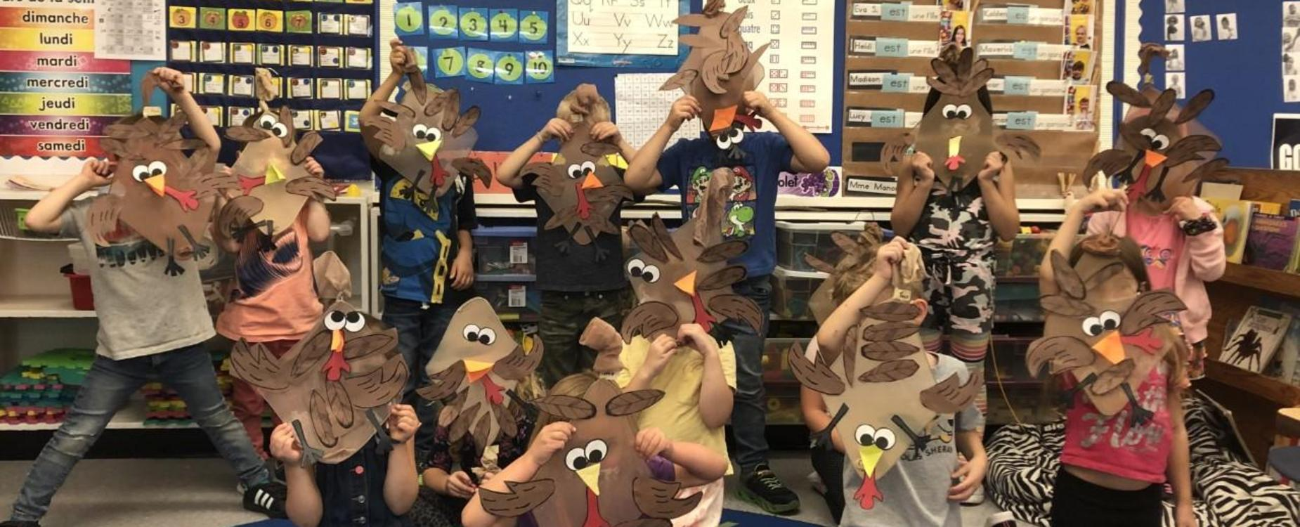 students showing off their turkey craft