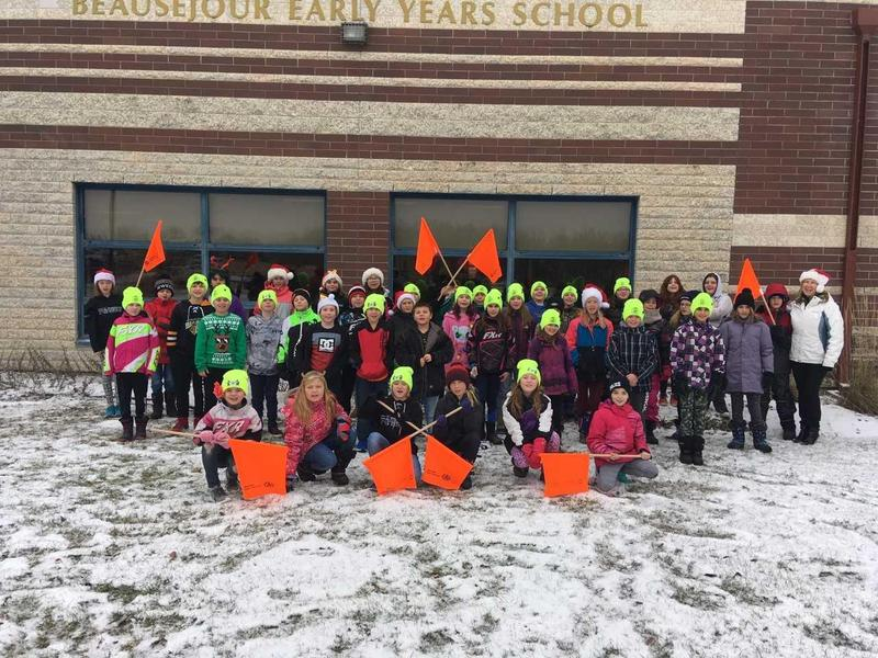 Patrol students pose in front of the school