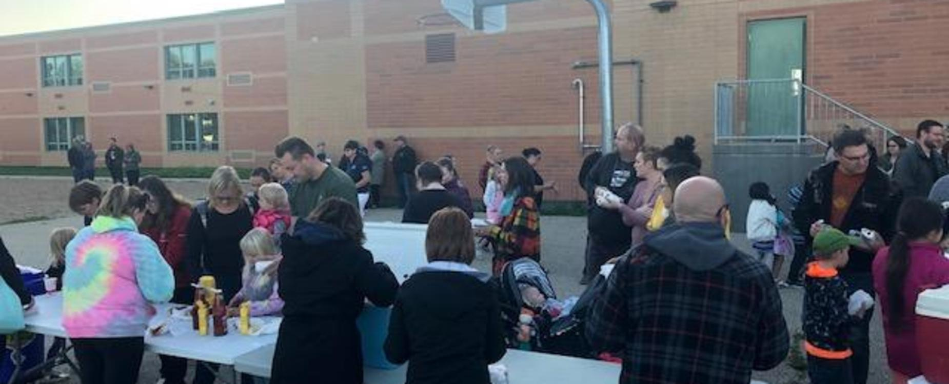 families enjoying a welcome back barbeque at the school