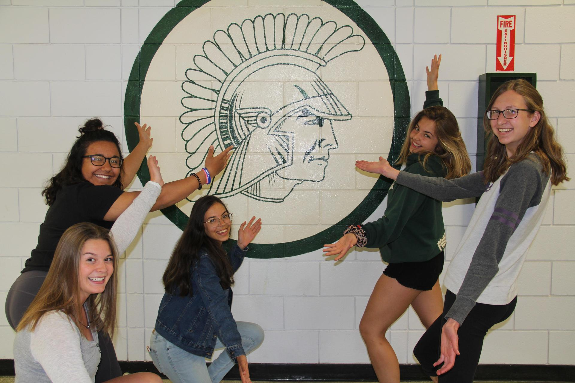 Students showing off the Spartans wall emblem
