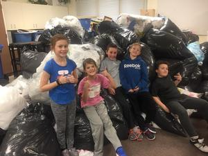 Students in front of the bags collected for Bag Up Manitoba