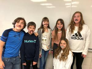 6 Centennial School Students with fake mustaches pose for a picture to celebrate Movember