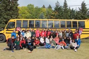 students in front of bus