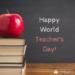 happy world teachers day written on chalkboard