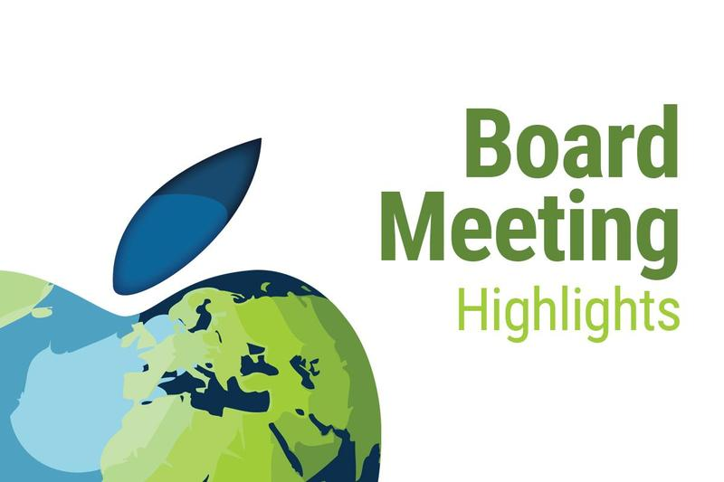 Blue and green apple in bottom left corner with Board Meeting Highlights on the right