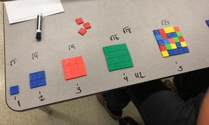 Different equations on a table using small colored tiled pieces