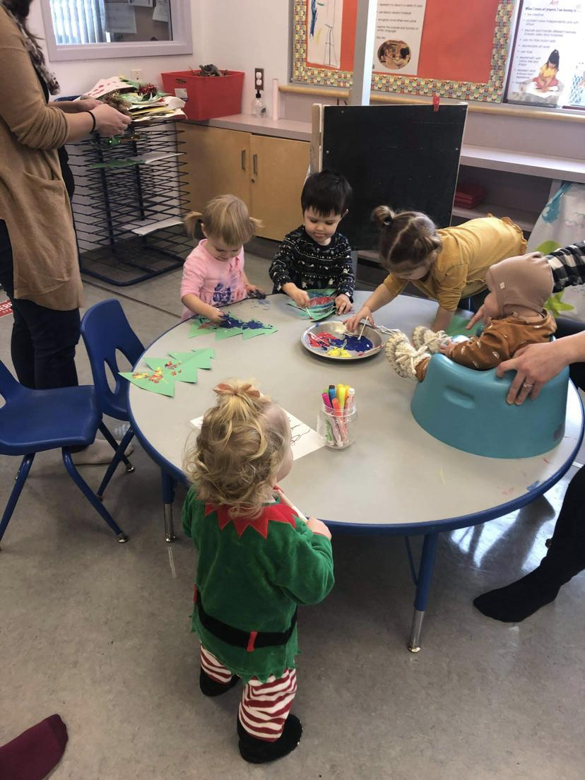 toddlers sitting at a table
